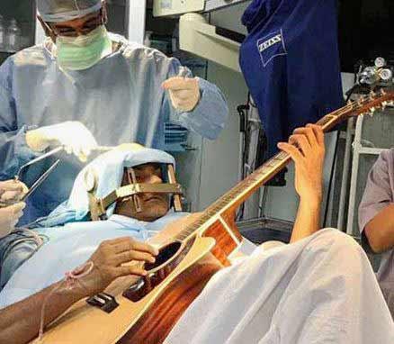 man-plays-guitar-during-brain-surgery